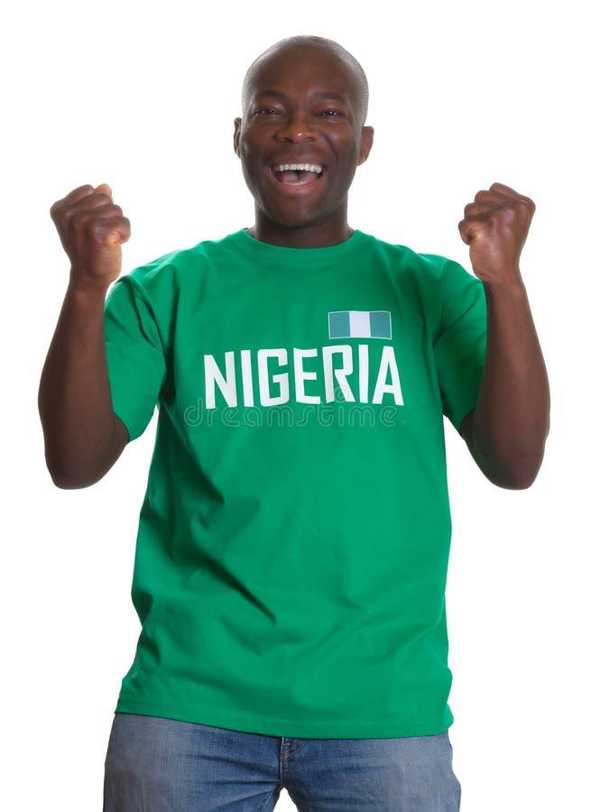 Fan de deportes que anima de Nigeria fotografía de archivo libre de regalías