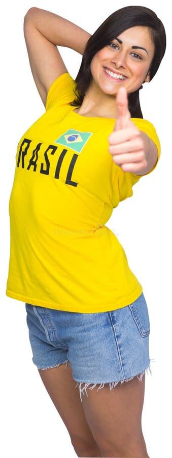 Fan de futebol bonito no tshirt de Brasil fotografia de stock