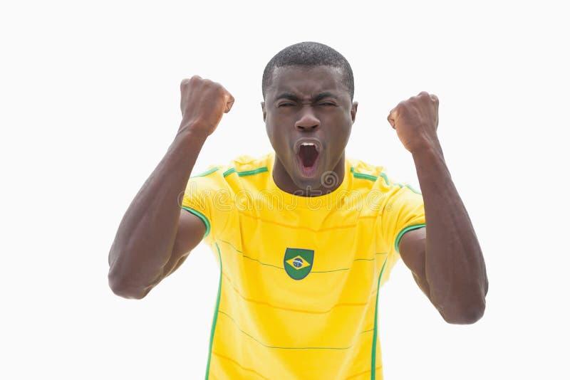 Fan de futebol brasileiro Cheering no amarelo foto de stock royalty free