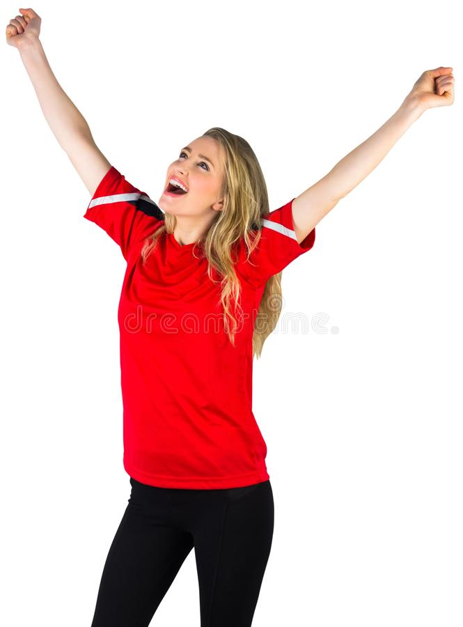 Fan de futebol Cheering no vermelho imagens de stock