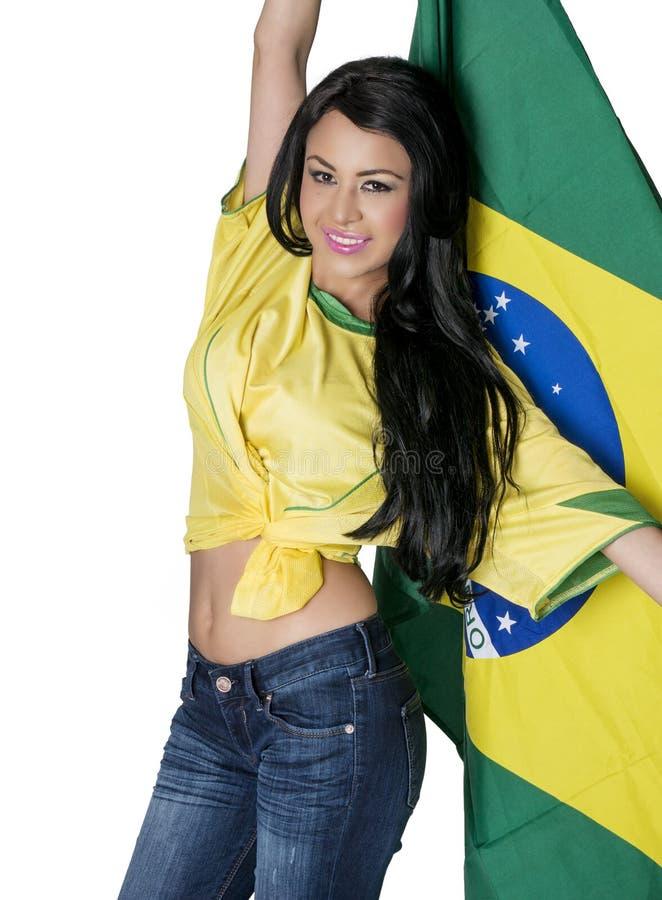 Fan de futebol do futebol de Brasil que veste a parte superior verde e amarela. fotos de stock
