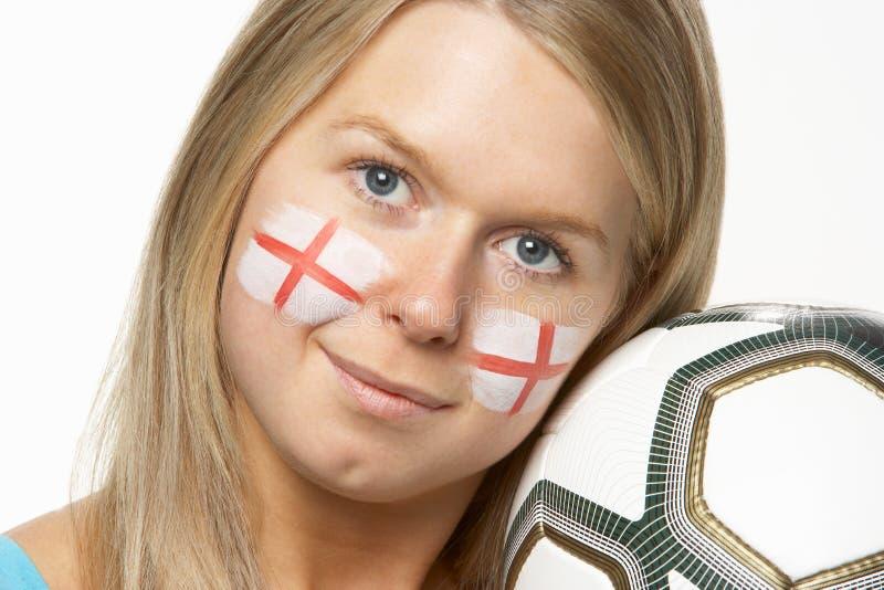 Fan de futebol fêmea novo com a bandeira do St Georges imagem de stock royalty free