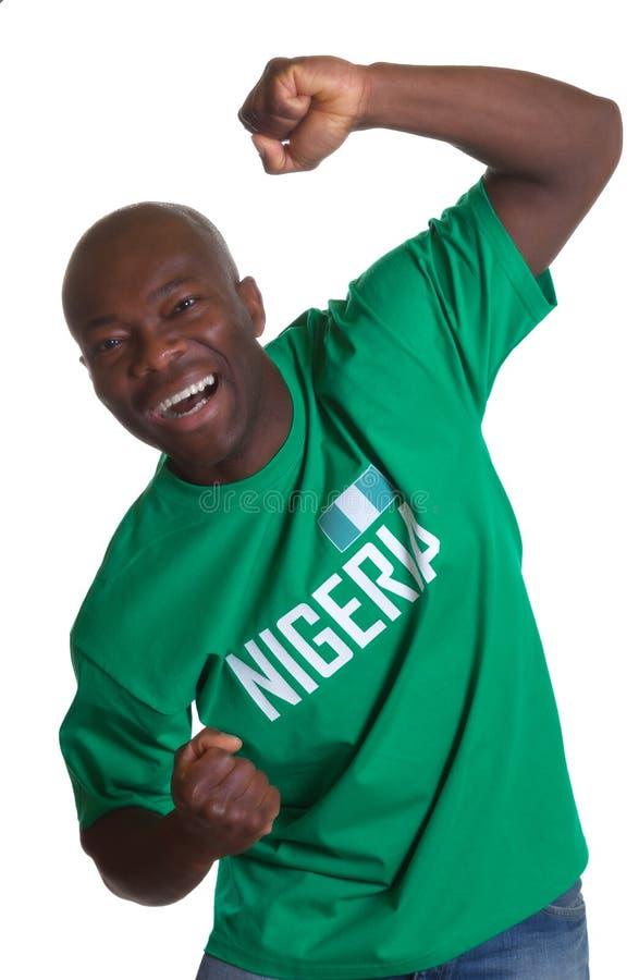 Fan di sport pazzo dalla Nigeria immagini stock