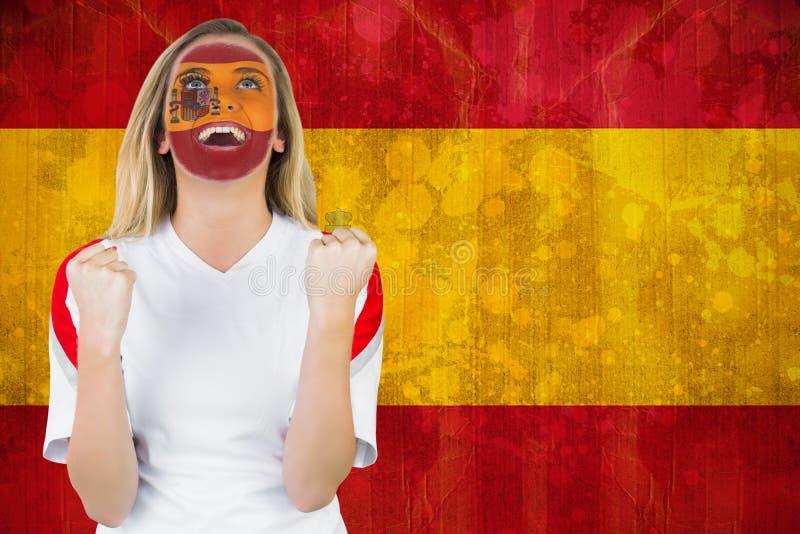Fan enthousiaste de l'Espagne dans encourager de peinture de visage images stock