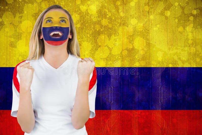 Fan enthousiaste de la Colombie dans encourager de peinture de visage photographie stock libre de droits