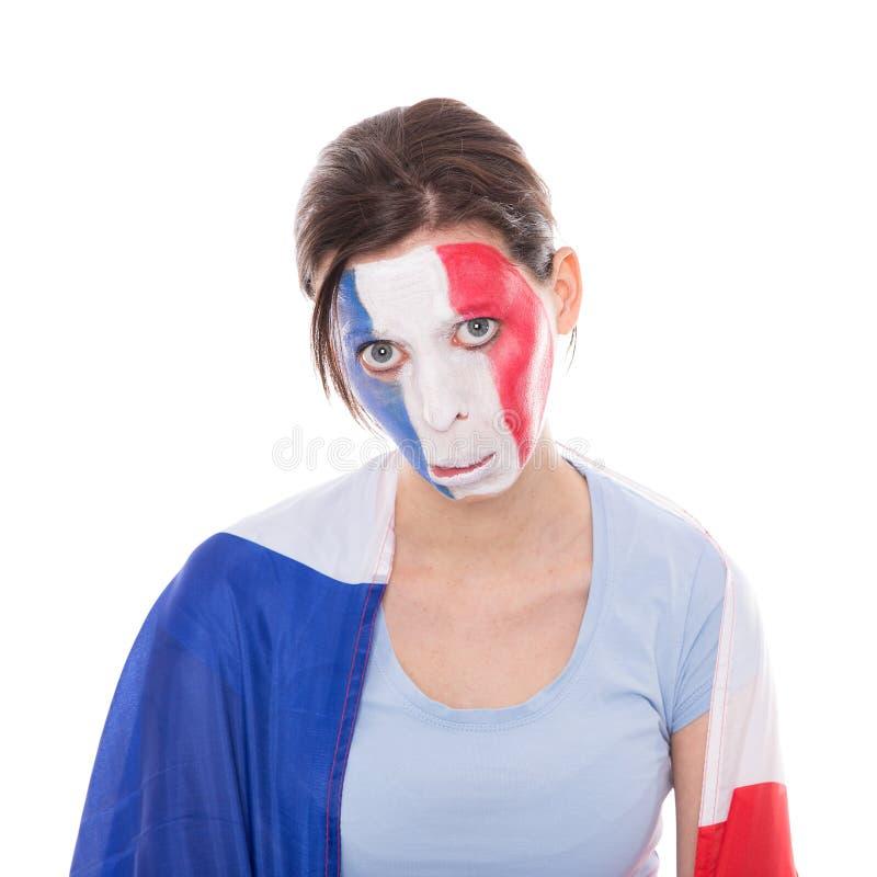 Fan française tristement femelle avec un drapeau photos libres de droits