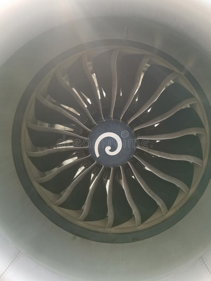 Into the fan - looking into a jet engine with some sunflare modern jet engine royalty free stock images