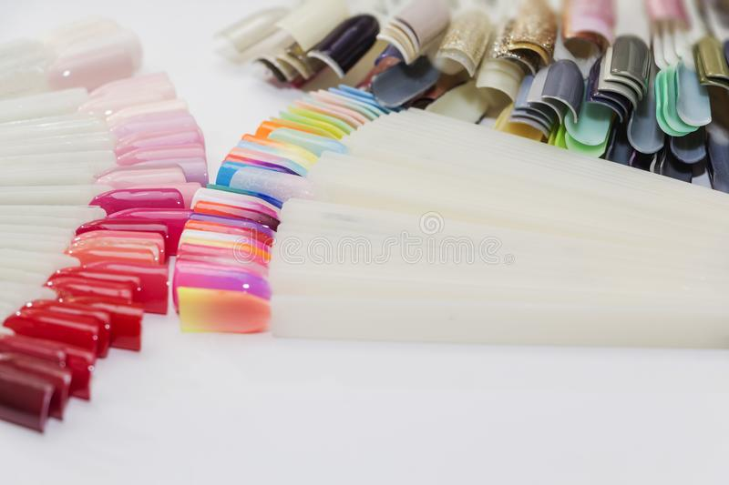Fan of nail art polish tips samples isolated on white. royalty free stock image