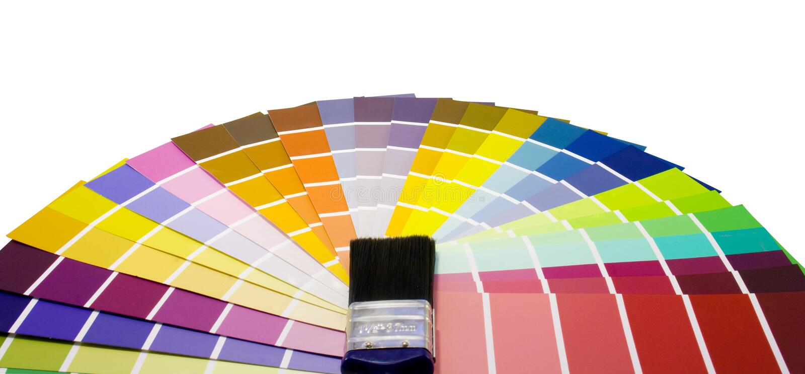 Fan of paint colour swatches and brush. On a white background stock image