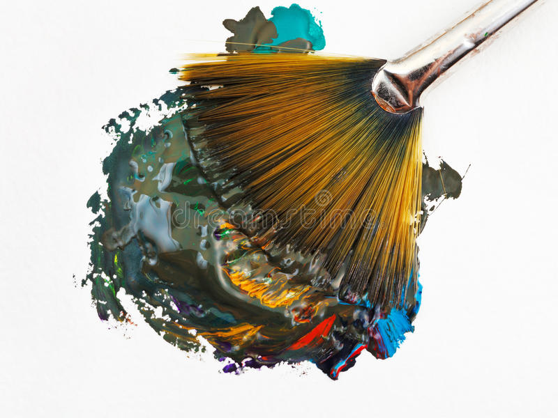 Fan paintbrush blends multicolored watercolors royalty free stock photo