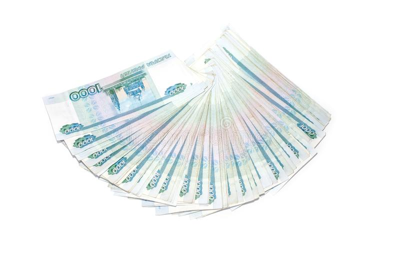 Fan of Russian money banknotes rouble on white background. in nominal value of one thousand. Rich concept. Russian money banknotes currency rouble on white stock photo