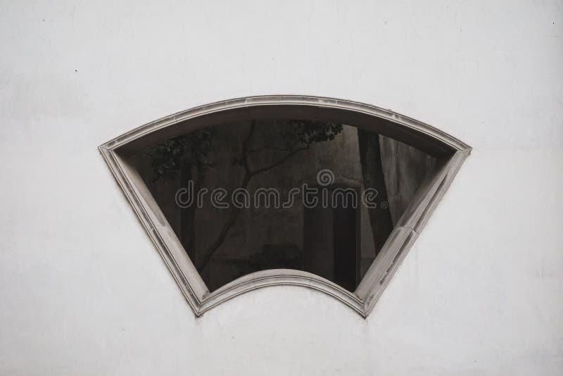 Fan shaped window on white wall in  Tongli, Jiangsu, China. Fan shaped window on white wall in the old town of Tongli, Jiangsu, China stock image