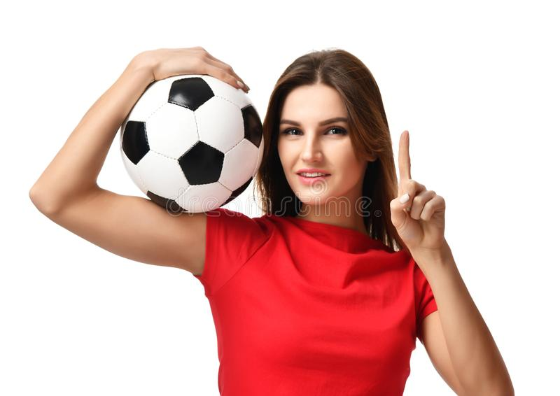 Fan sport woman player in red uniform hold soccer ball celebrating point one finger up free text copy space. Isolated on white background royalty free stock photography