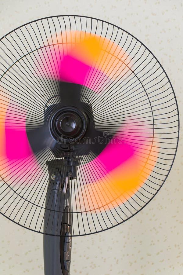 The fan of the stand. Copper retro fan. Vintage electric fan. Metal fan. Pedestal. Cooling fans royalty free stock photo