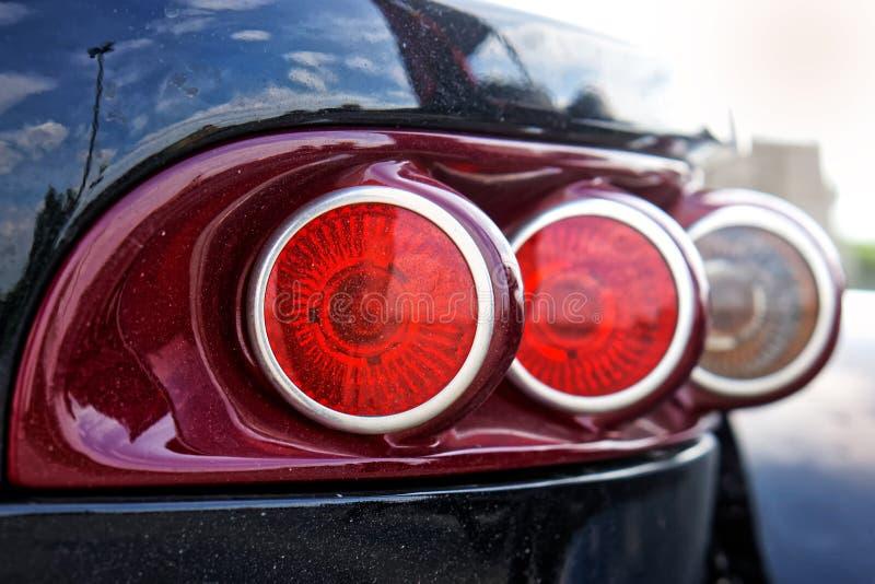 Fanali posteriori - trike di modo del segnale di giro e della luce dei freni - triciclo immagine stock