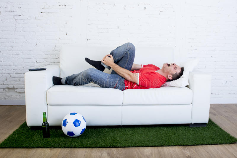 Couch Ball Extraordinary Fanatic Football Fan Lying On Couch Sofa With Ball  On Green Grass .