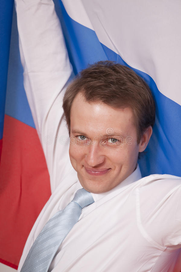 Fanatischer Mann mit russischer Markierungsfahne lizenzfreies stockfoto