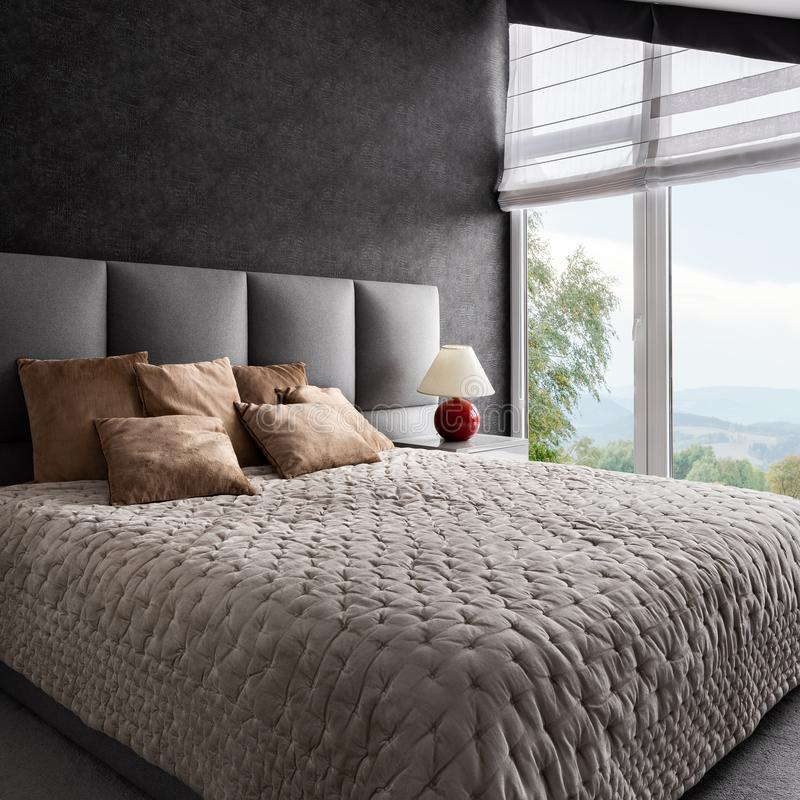 Fancy bedroom with window wall royalty free stock photo