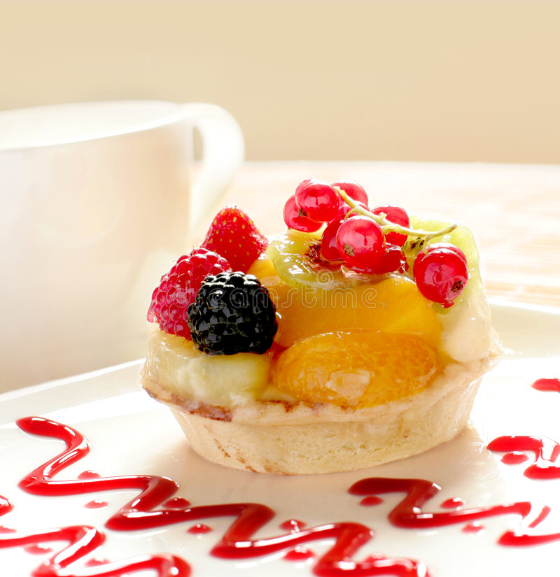 Fancy cake with a cup of tea or coffee royalty free stock image