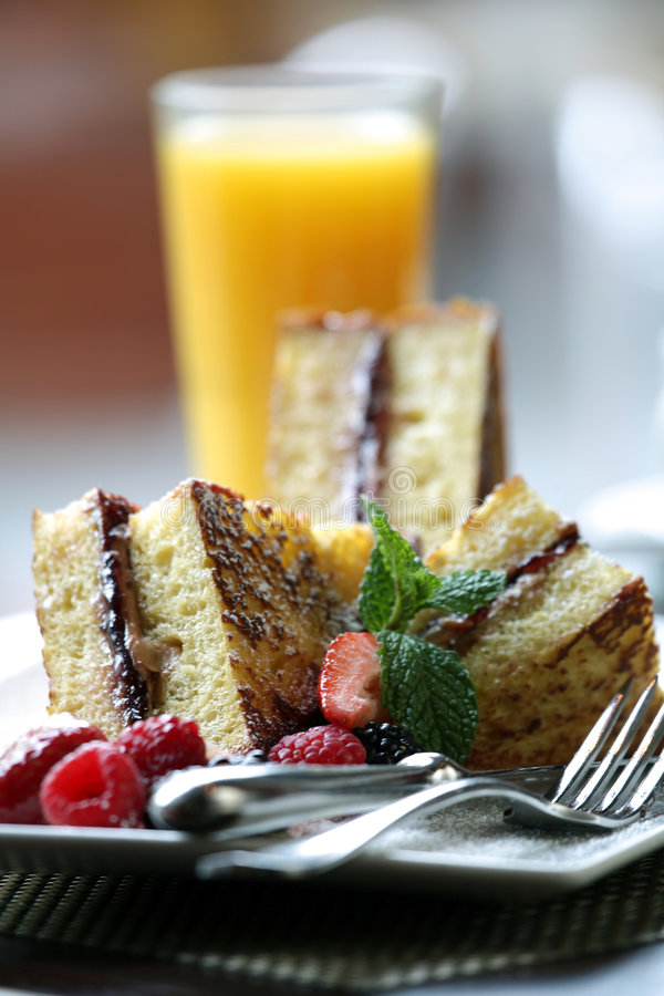 Fancy Desserts. Delicious French Toast Breakfast with Juice royalty free stock photography