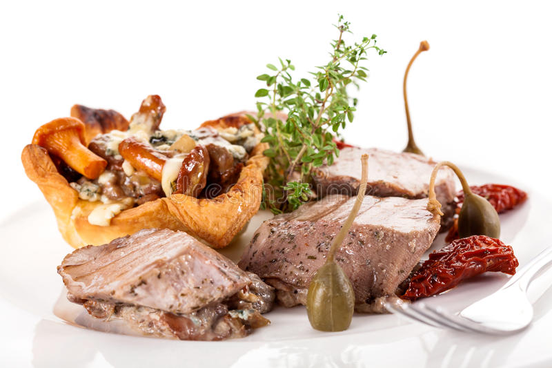 Fancy dinner with meat and mushrooms. Fancy dinner with meat, mushrooms and dried tomatoes royalty free stock image