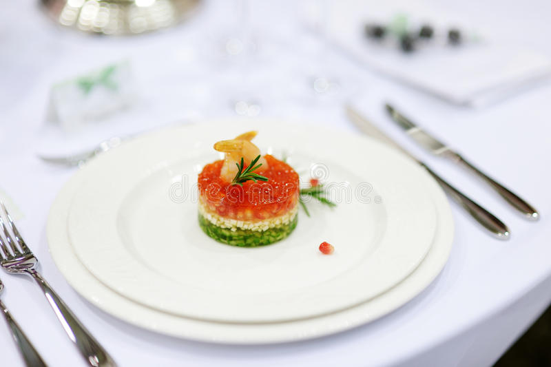 Fancy fish dish. On a white plate stock images