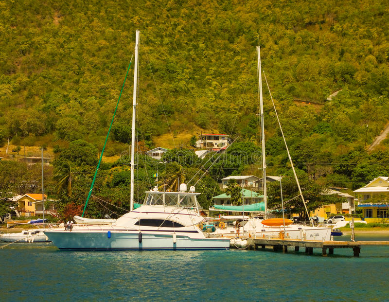 A fancy fishing boat tied up at bequia's marina royalty free stock photography