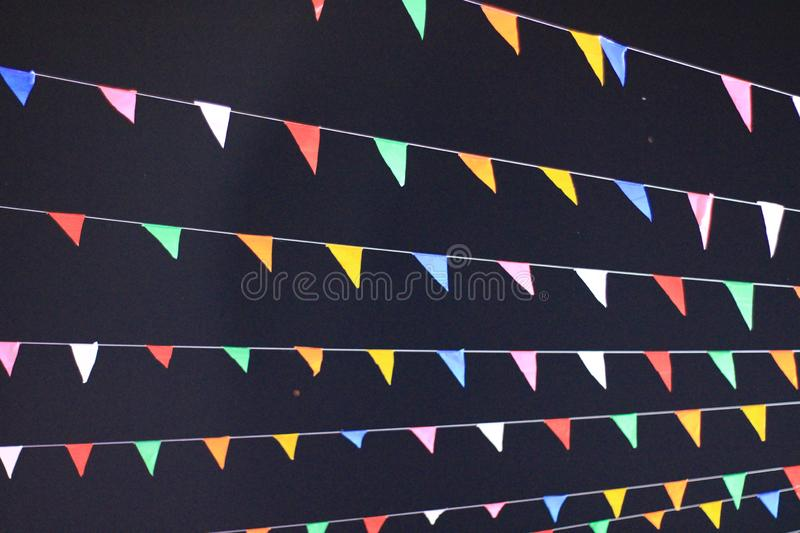 The fancy flags with the night skies background. royalty free stock photography