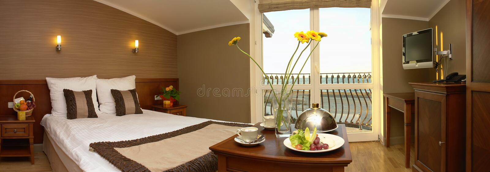 Fancy hotel room with meal stock images