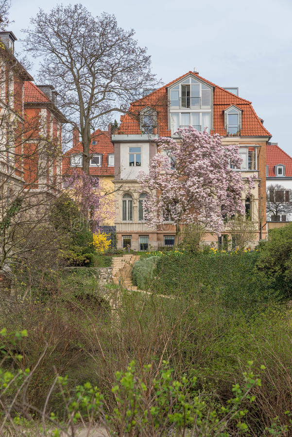 Fancy house in Brunswick, Germany. Fancy Home in Spring with overcast weather and blooming trees and bushes in Braunschweig, Germany stock image