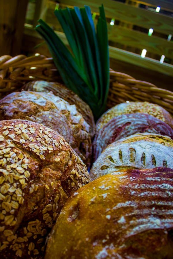 Fancy loaves of bread in a Basket. Fancy loaves of gourmet bread in a basket with a leek stock photography