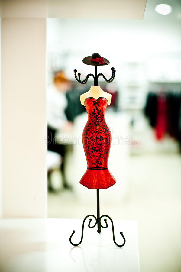 Fancy mannequin. A fancy red shop mannequin against a blurred background royalty free stock images