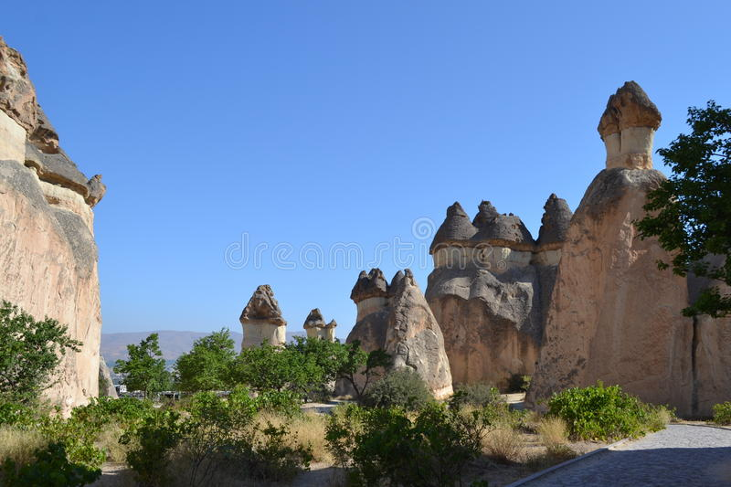 The fancy mushroom houses in Cappadocia region. The nature landscape of Cappadocia region Turkey, unique historical and cultural heritage, summer time stock images