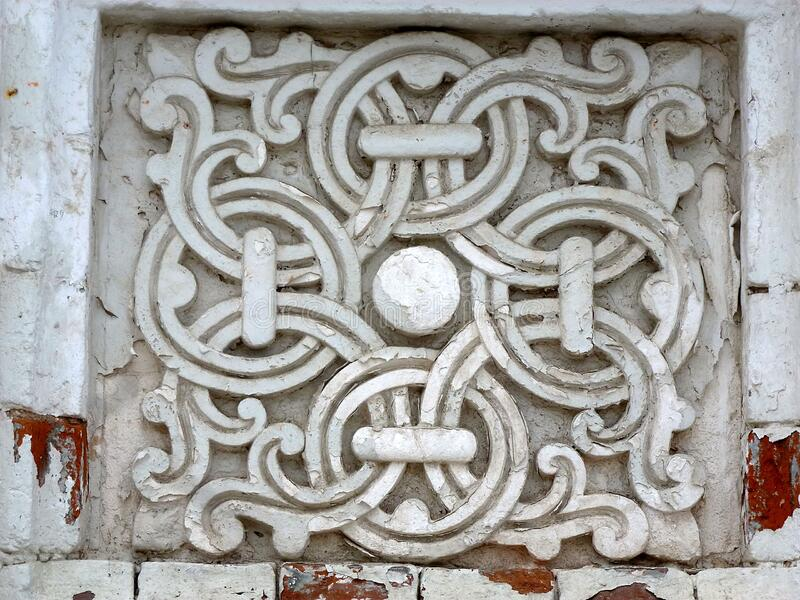 Fancy patterns in a square niche, carved out of stone. Heritage of ancient stone carvers , admiring the complexity of the patterns and the work done royalty free stock image