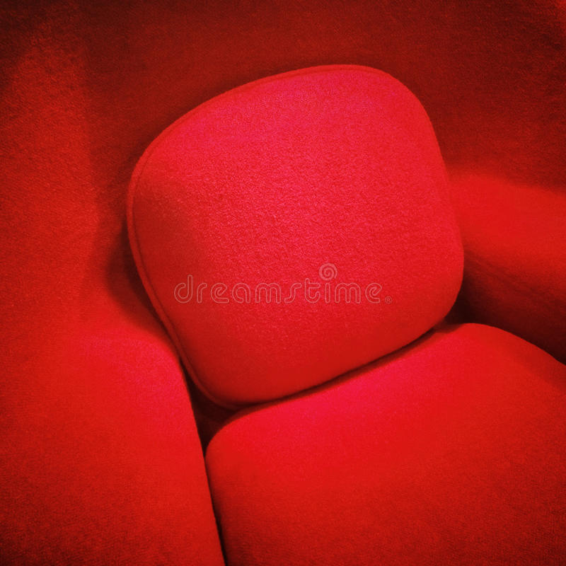 Fancy red armchair. Close-up of a fancy red armchair stock photos
