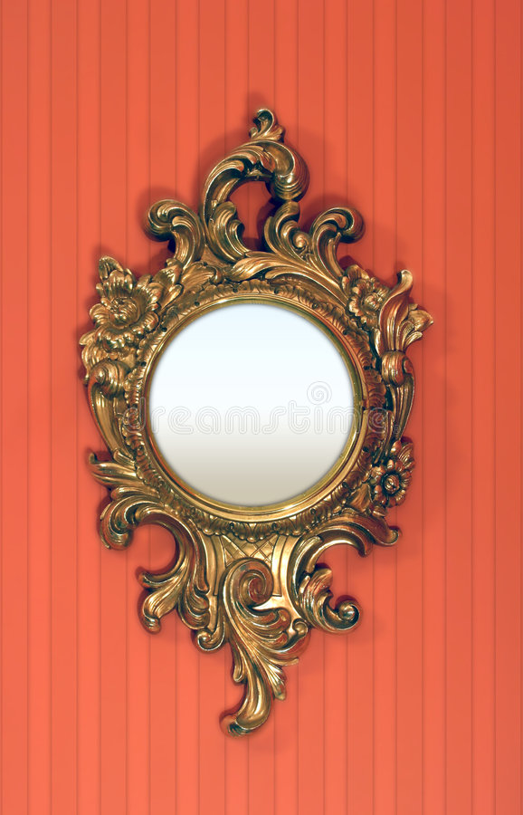 Fancy Round Picture Frame. A fancy round picture frame against a red striped wall royalty free stock photos
