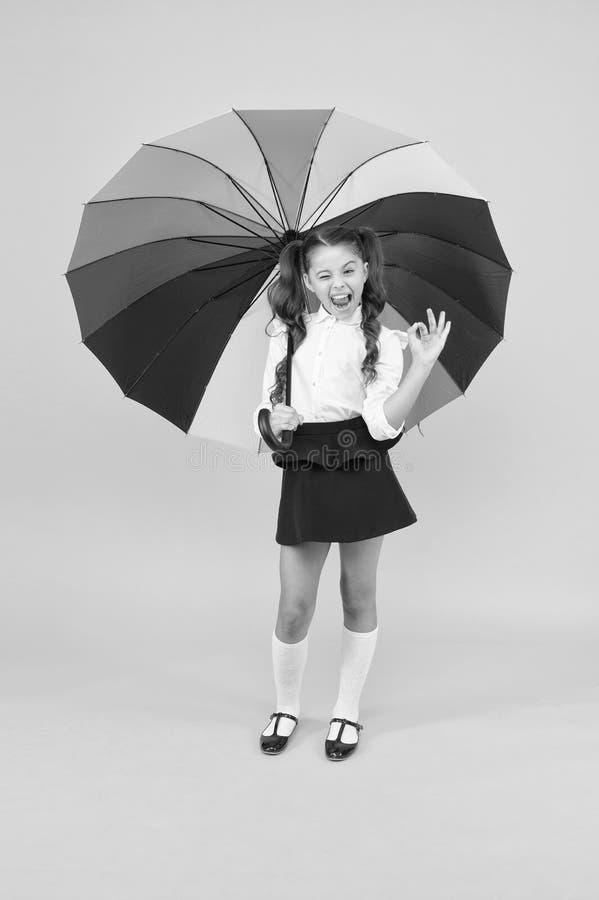 Fancy schoolgirl. Girl with umbrella. Rainy day. Happy childhood. Rainbow style. Kid happy with umbrella. Fall weather. Forecast. Fashion accessory. Rainy royalty free stock images