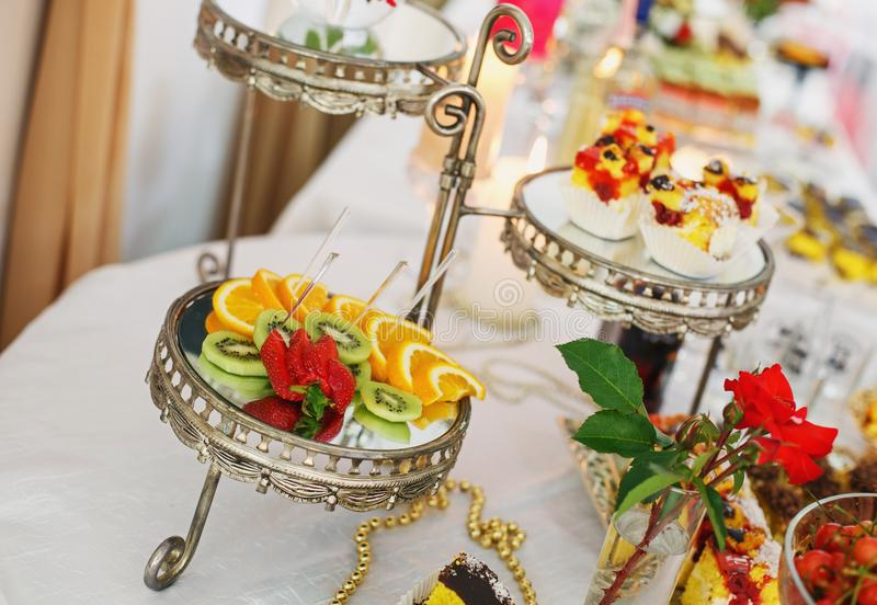 Fancy served fruit buffet on luxurious party table in restaurant. Corporate event or wedding celebration royalty free stock image