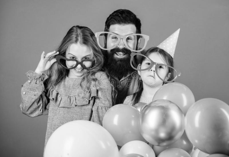 In fancy style. Father and girl children enjoying party time. Happy family celebrating birthday party. Family party stock images