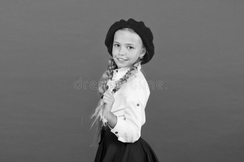 Fancy style. Little girl with braids ready for school. Do you speak french. School fashion concept. Schoolgirl wear. Formal school uniform and beret hat. Child stock image
