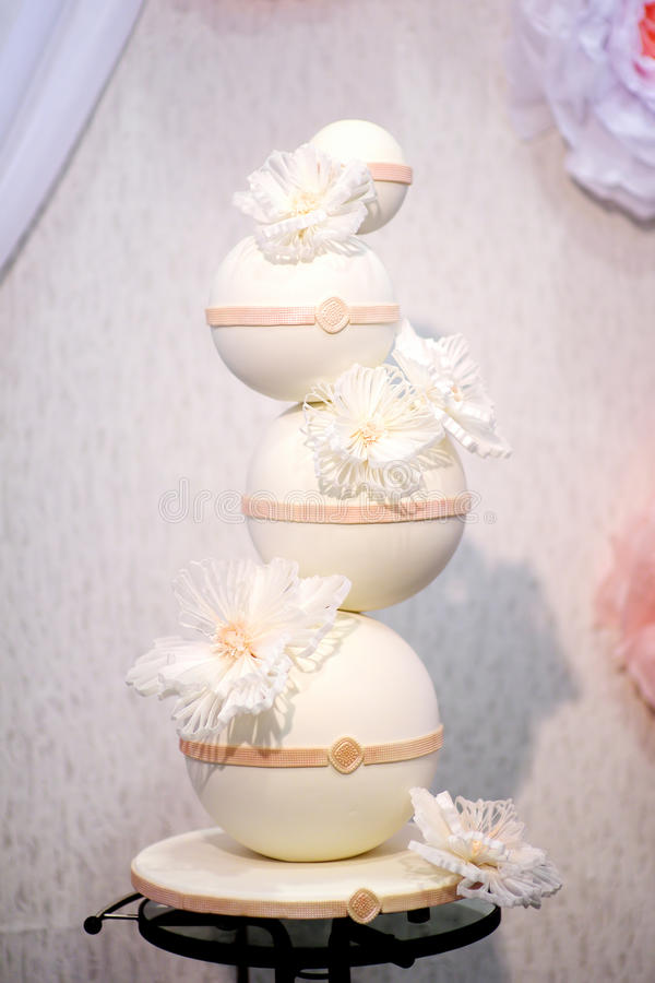 Fancy wedding cake made of big white bubbles stock photography
