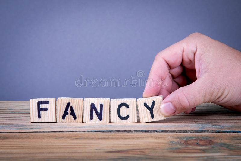 Fancy. Wooden letters on the office desk. Informative and communication background stock image