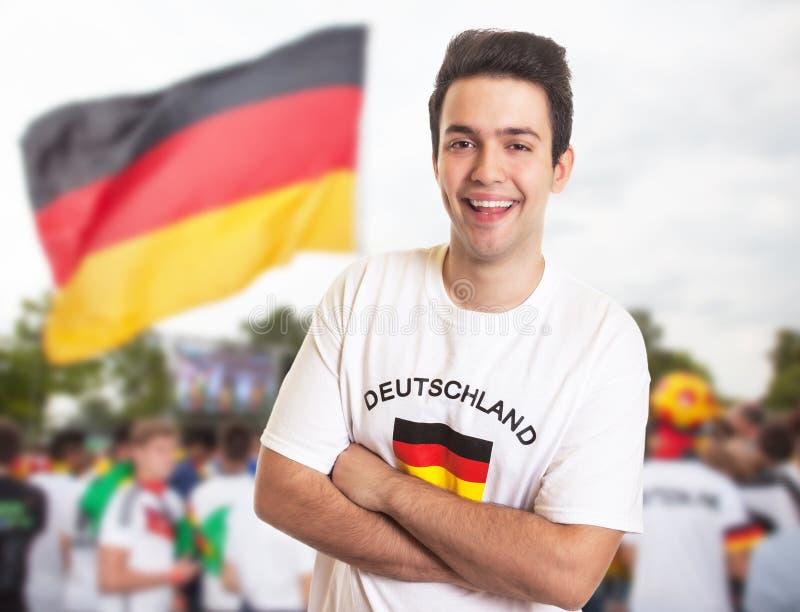 Fanen i tysk ärmlös tröja med annan fläktar royaltyfria foton