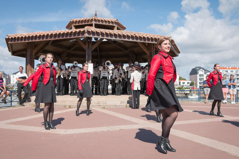 Fanfare dancing in the street stock images