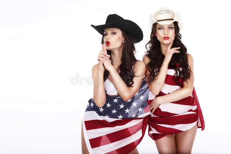 Fanny Women Cowgirls and American Flag. Fanciful Joyful Women Cowgirls and American Flag stock photos