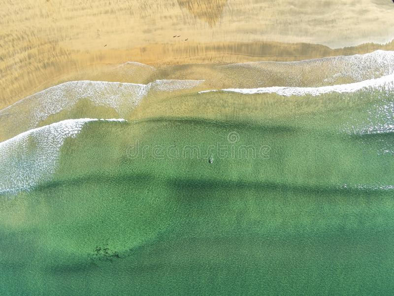 Fanore beach and Atlantic ocean, Aerial view, Water and sand texture. Warm sunny day. Fanore beach and Atlantic ocean, Aerial  top view, Water and sand texture stock image