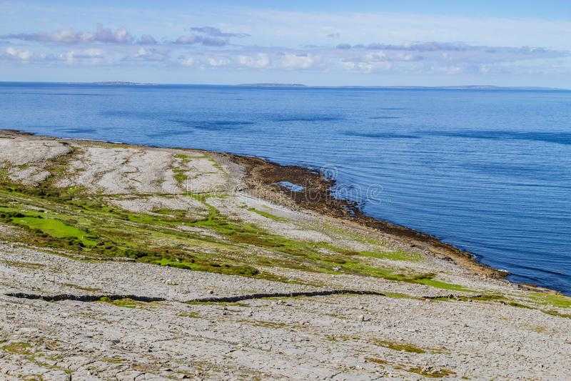Fanore beach in Burren mountain with Aran Islands in background. Fanore, Clare, Ireland royalty free stock images
