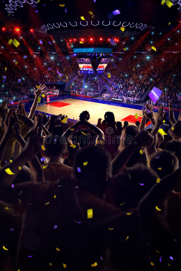 Fans on basketball court in game. Confetti and tinsel stock photos