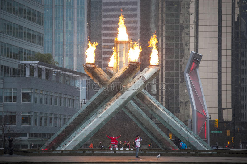 Fans Cheer At Olympic Flame In Vancouver Editorial Photography