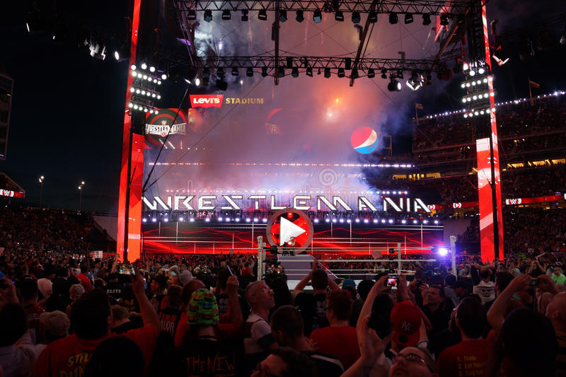 Fans cheer and record action on phones at close of Wrestlemania stock images